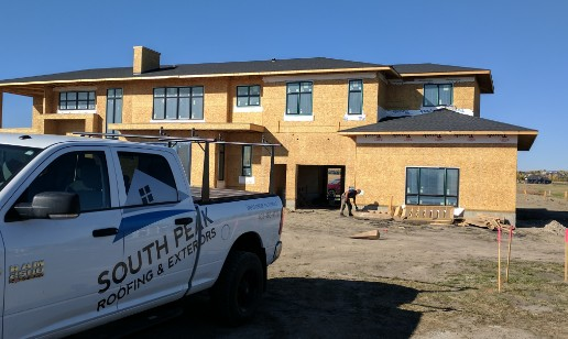 Custom build house. South Peak Truck parked in-front of it. Exterior service to be done to the house