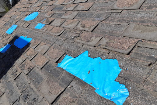 damaged roof being repaired. Damaged by years of not being maintained