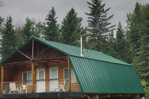 Cabin with newly installed metal roof