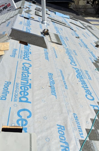 Residential roof in the process of installing insulation