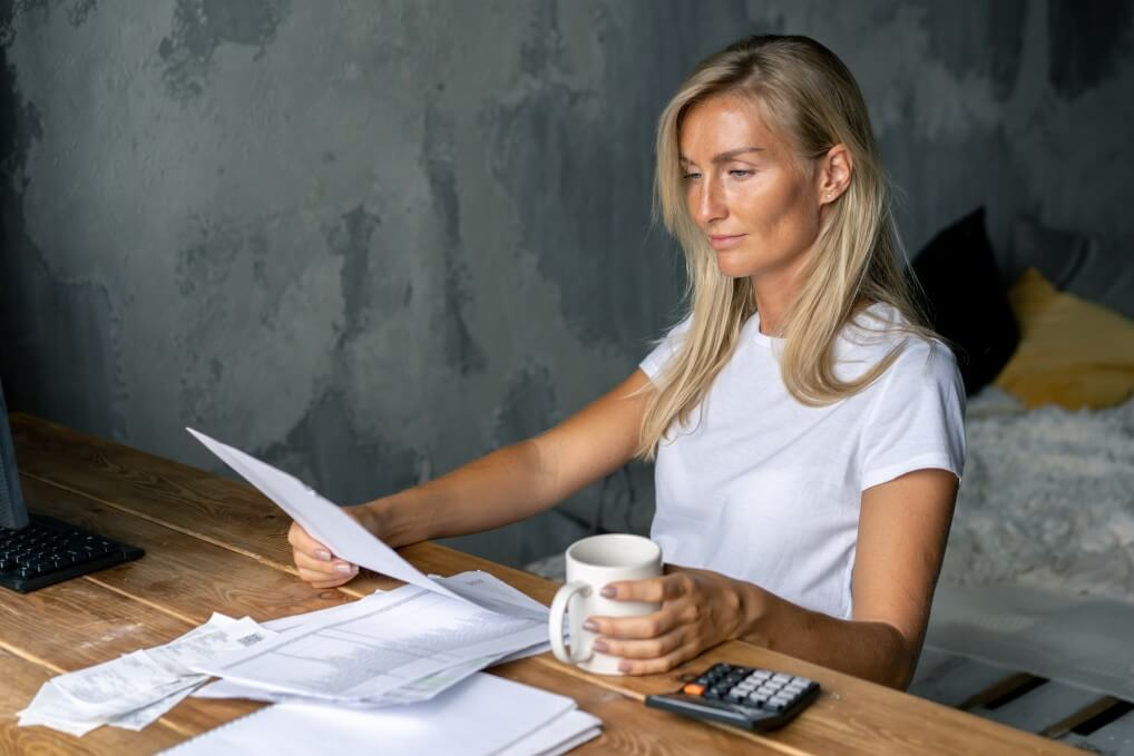 woman budgeting for repairs